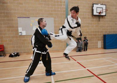 Master Slater kicks Master Harris