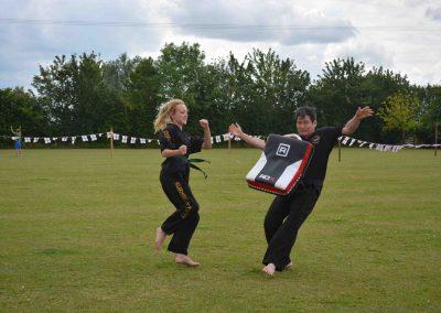 Summer fete demo. Michelle sends Master Slater flying